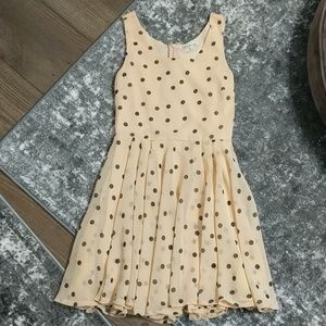 Peach and black polka dot dress